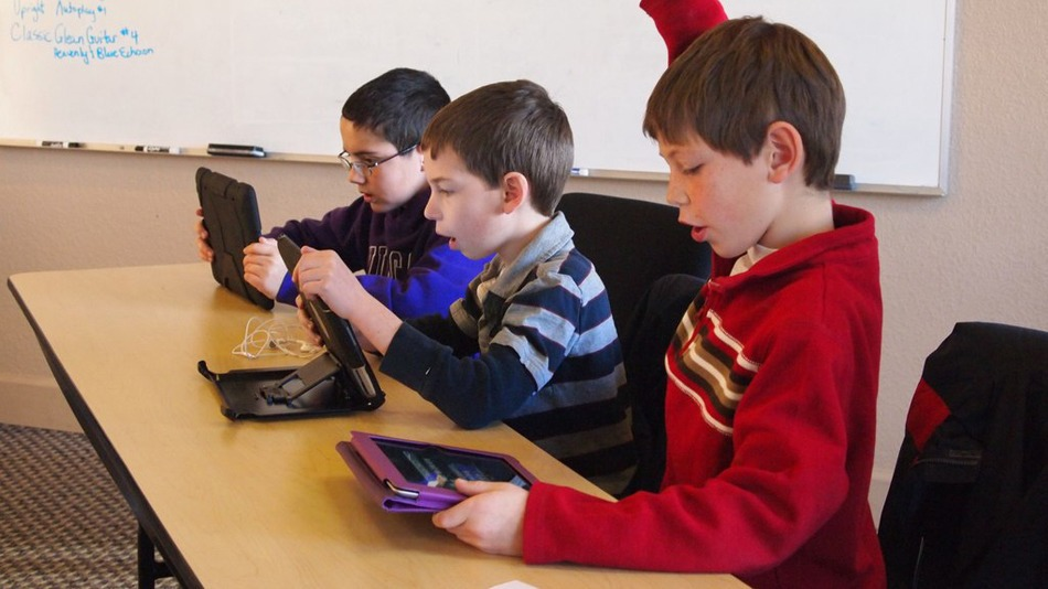 Photo of students participating in gamification in the classroom.