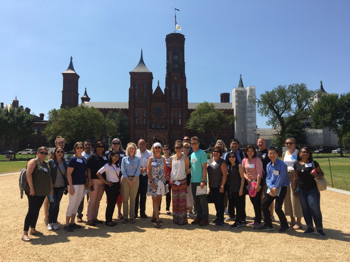 The Smithsonian National Museum of Natural History group poses outside the Smithsonian Castle.