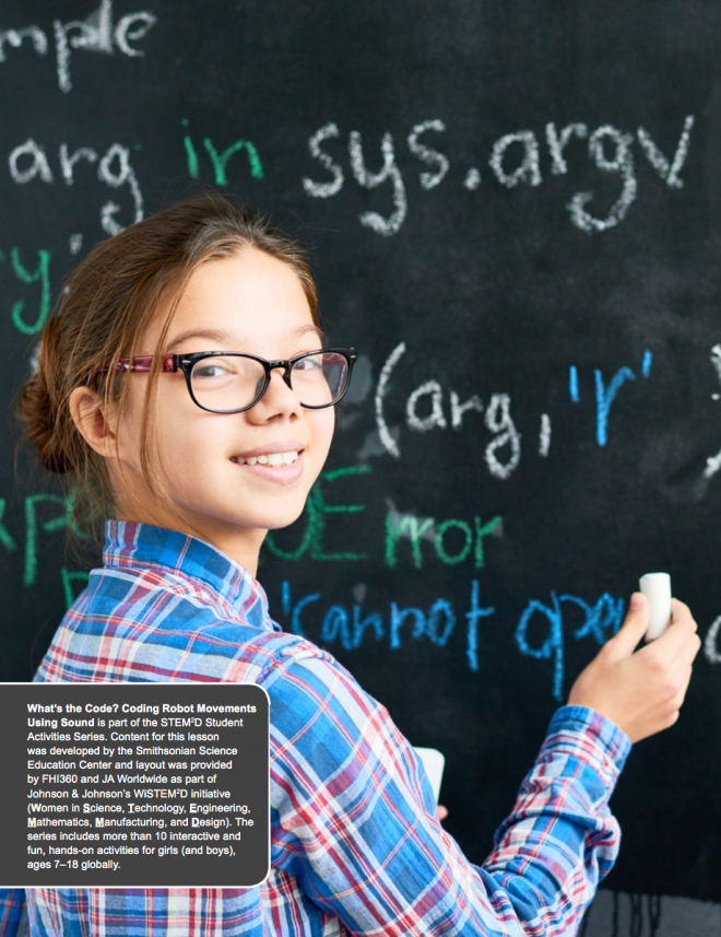 Image of a young female student writing on a blackboard