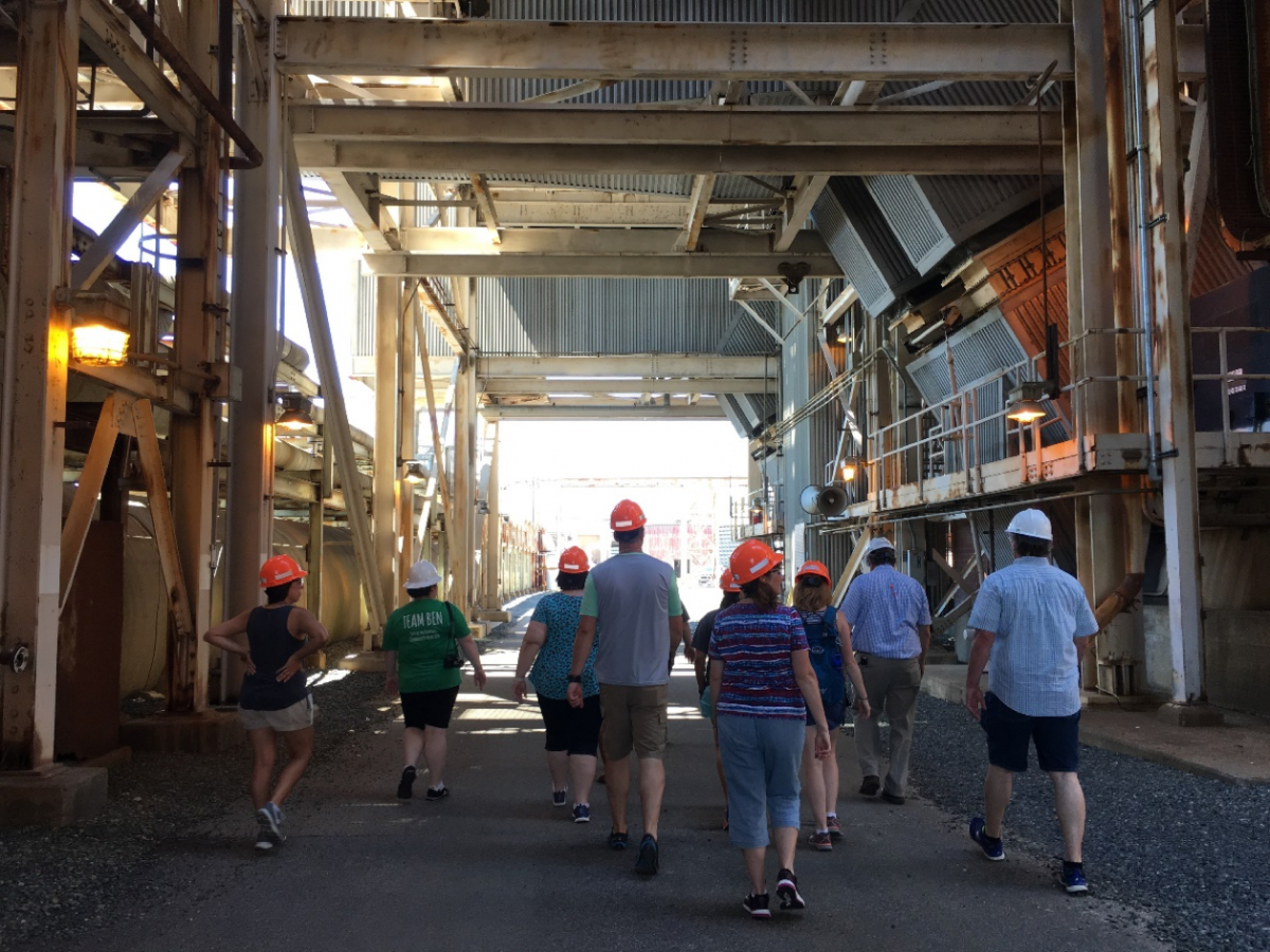 The group walks through the power plant