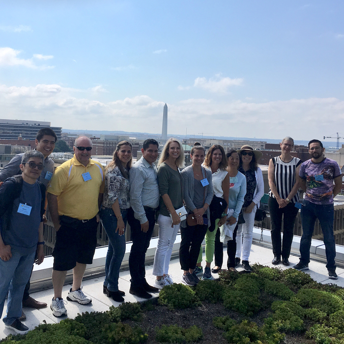 SPI Group on green rooftop of GWU's Science and Engineering Hall; Washington Monument in background