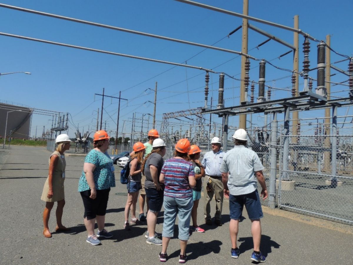 Participants learn about the transmission lines used to carry electricity to surrounding communities
