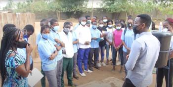 Students in Benin gather around a sanitation station