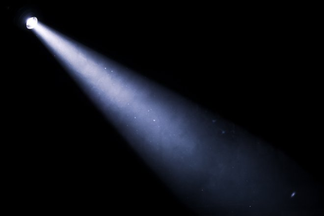 Photo of a beam of light coming from a flashlight